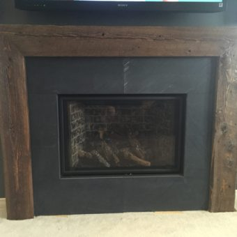 3-sided-barn-beam-fireplace-with-slate-tiles-close-up