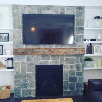 barn-beam-mantle-on-stone-fireplace