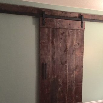 brown-barnwood-plank-pattern-barndoor-built-installed