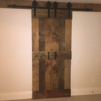 double-brown-barnwood-mid-rail-plank-barndoors-closed