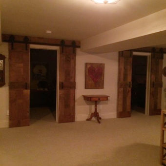 double-brown-barnwood-mid-rail-plank-barndoors-open-2-sets