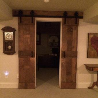 double-brown-barnwood-mid-rail-plank-barndoors-open