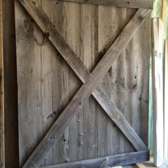 oversized-grey-barnwood-x-pattern-barndoor-installed