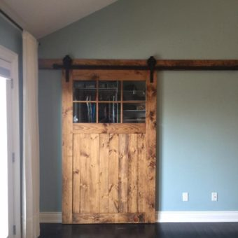 pine-stained-barn-door-with-glass-installed