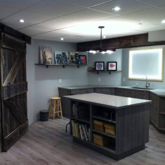 beam-cladded-with-barnwood-barnwood-shelves-and-barndoor